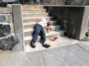 Man passed out on sidewalk